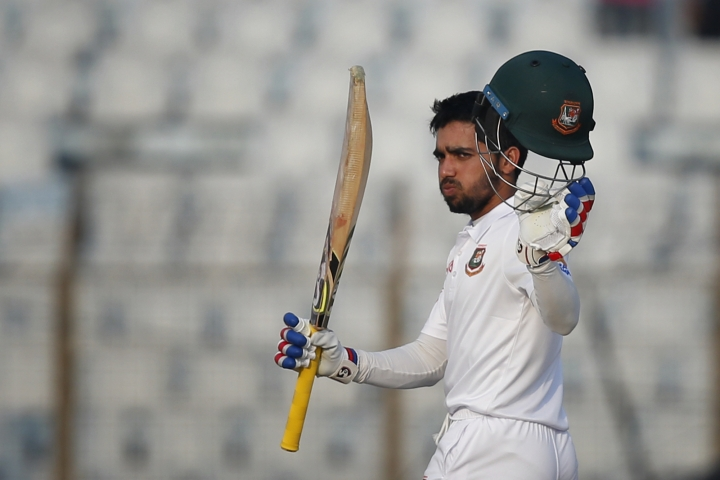 Bangladesh's Mominul Haque acknowledges the crowed after scoring hundred and fifty runs during the first day of their first test cricket match against Sri Lanka in Chittagong, Bangladesh, Wednesday, Jan. 31, 2018. (AP Photo/A.M. Ahad)
