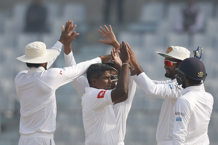 Sri Lanka's Rangana Herath, center, celebrate with his teammates the dismissal of Bangladesh's Mominul Haque during the second day of the first test cricket match in Chittagong, Bangladesh, Thursday, Feb. 1, 2018. (AP Photo/A.M. Ahad)