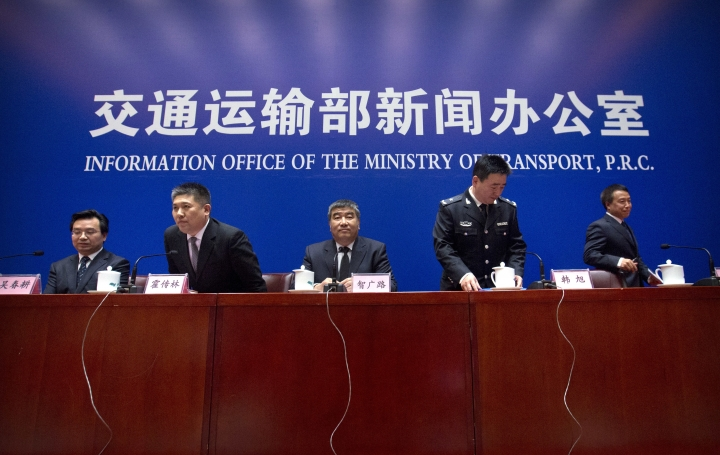Chinese officials arrive for a press conference about the Iranian oil tanker Sanchi, which exploded and sank after a collision in the East China Sea in January, at the Information Office of the Ministry of Transport in Beijing, Thursday, Feb. 1, 2018. Chinese officials say they are still debating whether to try to raise an Iranian oil tanker that sank last month with the loss of all 32 crew members. (AP Photo/Mark Schiefelbein)