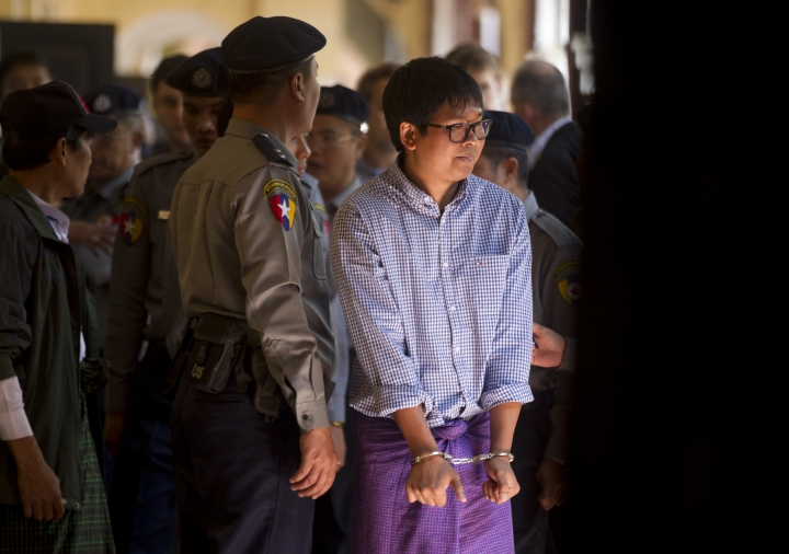 Reuters journalist Wa Lone is seen outside the court during a break Thursday, Feb.1, 2018, outside of Yangon, Myanmar. A lawyer for the two Reuters journalists Wa Lone and Kyaw Soe Oo, charged with illegally handling government secrets, says a court had denied their request to be released on bail. (AP Photo/Thein Zaw)