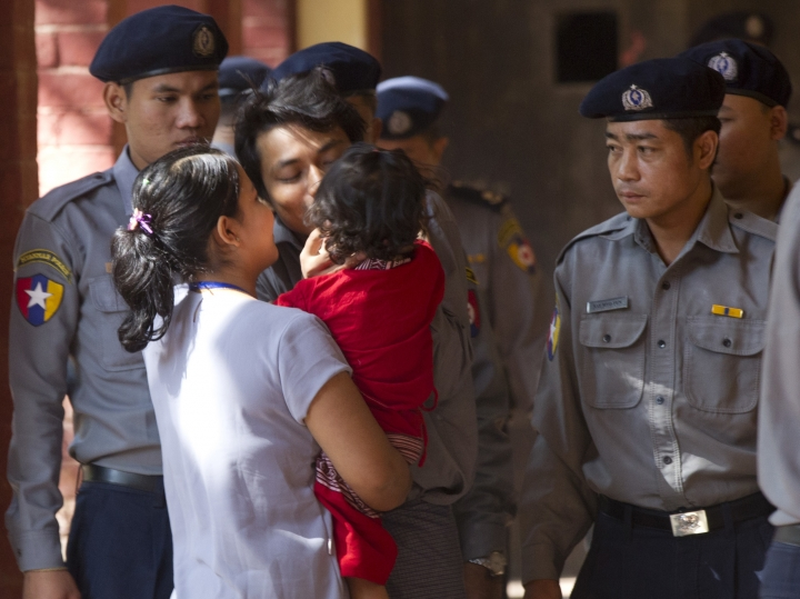 "Reuters journalist Kyaw Soe Oo, center, is welcomed by his wife and daughter upon arrival at the court for their trial Thursday, Feb. 1, 2018, on the outskirts of Yangon, Myanmar. The trial resumes for the two Reuters journalists charged of violating state secrets. Wa Lone and Kyaw Soe Oo were arrested Dec. 12 for acquiring ""important secret papers"" from two police officers who had worked in Rakhine state, where abuses widely blamed on the military have driven more than 630,000 Rohingya Muslims to flee into neighboring Bangladesh. (AP Photo/Thein Zaw)"