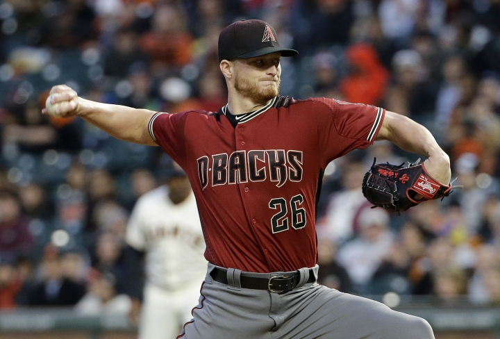FILE - In this April 12, 2017, file photo, Arizona Diamondbacks pitcher Shelby Miller (26) throws against the San Francisco Giants during the first inning of a baseball game in San Francisco. Miller has won his salary arbitration case against Arizona after missing most of last season due to a torn elbow ligament, a decision that gave players a 2-0 record in decisions this year. Miller was awarded a $200,000 raise to $4.9 million on Thursday, Feb. 1, 2018, by arbitrators. (AP Photo/Jeff Chiu, File)