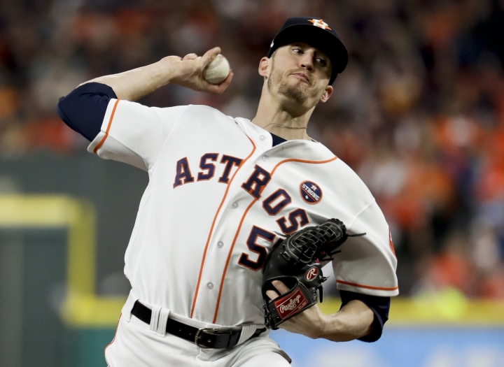 FILE - In this Saturday, Oct. 28, 2017 file photo, Houston Astros relief pitcher Ken Giles throws against the Los Angeles Dodgers during the ninth inning of Game 4 of baseball's World Series in Houston. Houston closer Ken Giles and Miami first baseman Justin Bour went to hearings Thursday, Feb. 1, 2018. Giles asked Phillip LaPorte, Andrew Strongin and Skratek for a raise from $555,100 to $4.6 million, $400,000 more than Houston's offer.(AP Photo/Matt Slocum, File)