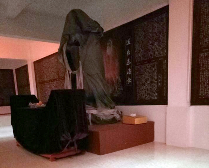 """In this undated photo provided by Deng Xichan, a statue of Confucius stands in a hallway at a female morality school in Changsha in southern China's Hunan Province. So-called """"female morality schools"""" where women are taught to be subservient to men have sparked a storm of criticism in China. Such schools teach women not to fight back if their husbands beat them, avoid career aspirations and to do more housework. Deng said that every evening, she was required to bow in front of a statue of Confucius and participate in group confessions at the morality school she attended. (Deng Xichan via AP)"""