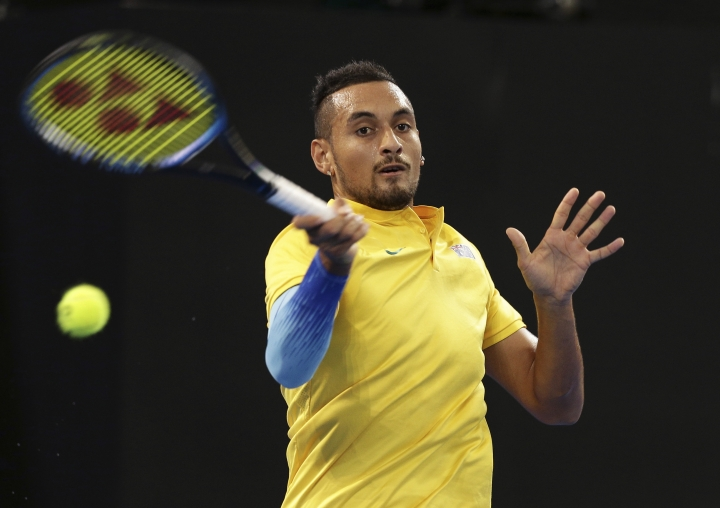 Nick Kyrgios of Australia plays a shot in his match against Jan-Lennard Struff of Germany at the Davis Cup World Group first round in Brisbane, Australia, Friday, Feb. 2, 2018. (AP Photo/Tertius Pickard)