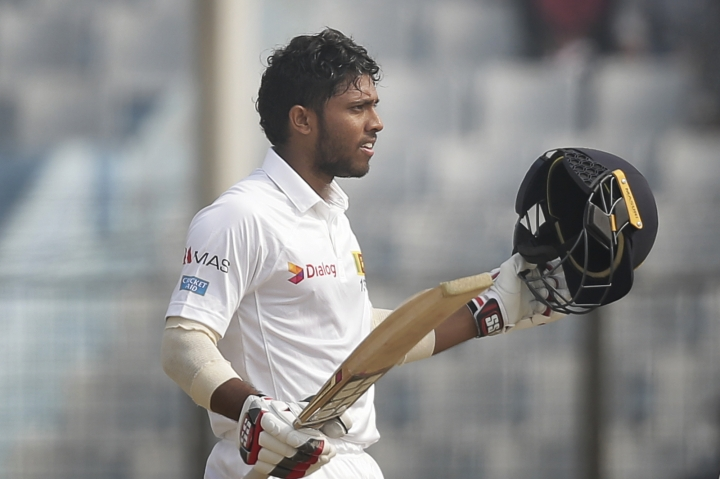 Sri Lanka's Kusal Mendis acknowledges the crowd after scoring hundred runs during the third day of their first test cricket match against Bangladesh in Chittagong, Bangladesh, Friday, Feb. 2, 2018. (AP Photo/A.M. Ahad)
