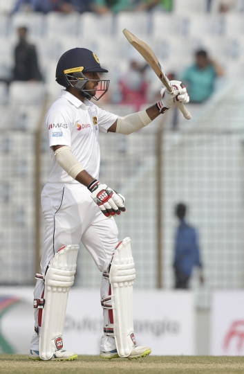 Sri Lanka's Kusal Mendis acknowledges the crowd after scoring hundred and fifty runs during the third day of their first test cricket match against Bangladesh in Chittagong, Bangladesh, Friday, Feb. 2, 2018. (AP Photo/A.M. Ahad)
