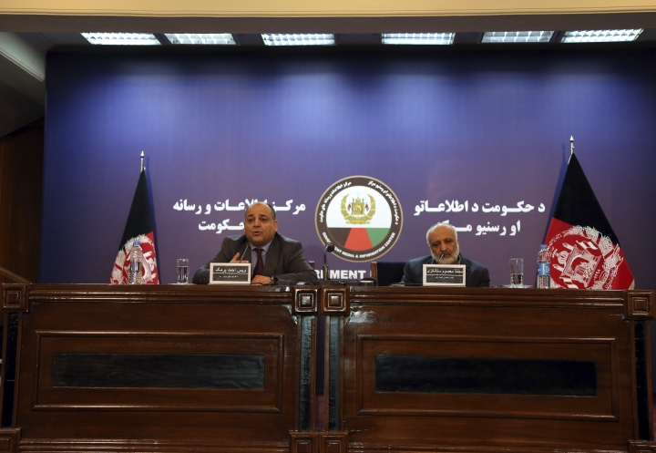 Wais Ahmad Barmak, interior minister, left, and Masoom Stanekzai Afghanistan's intelligence chief, right, speaks during a joint press conference in Kabul, Afghanistan, Thursday, Feb. 1, 2018. At the news conference Wais Ahmed Barmak said they has given neighboring Pakistan confessions and other proof that the militants who carried out a recent series of attacks were trained in Pakistan and that Taliban leaders there are allowed to roam freely. (AP Photo/Rahmat Gul)