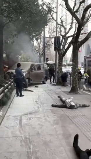 EDS NOTE: GRAPHIC CONTENT In this image taken from cellphone video provided to the Associated Press, rescuers attend to victims after a minivan carrying gas tanks plowed into pedestrians along a street in Shanghai, Friday, Feb. 2, 2018. A minivan plowed into pedestrians on a sidewalk in downtown Shanghai on Friday, sending more than a dozen people to hospitals. (AP Photo)