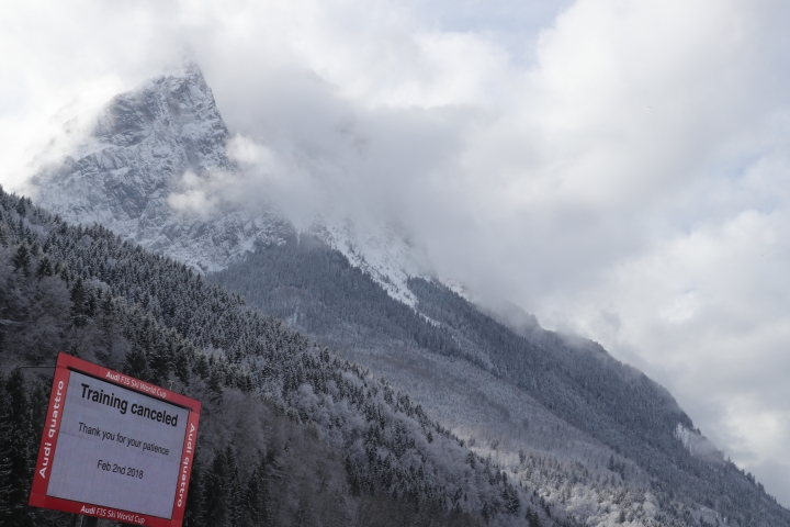 """A sign reads: Training Canceled, in Garmisch-Partenkirchen, Germany, Friday, Feb. 2, 2018. The training for the women's downhill World Cup was canceled due to bad weather conditions. he International ski federation says course workers need more time as """"conditions on the slope"""" after Thursday's rain and snowfall are not good enough to stage the training, despite improved weather with spells of sunshine. (Stephan Jansen/dpa via AP)"""