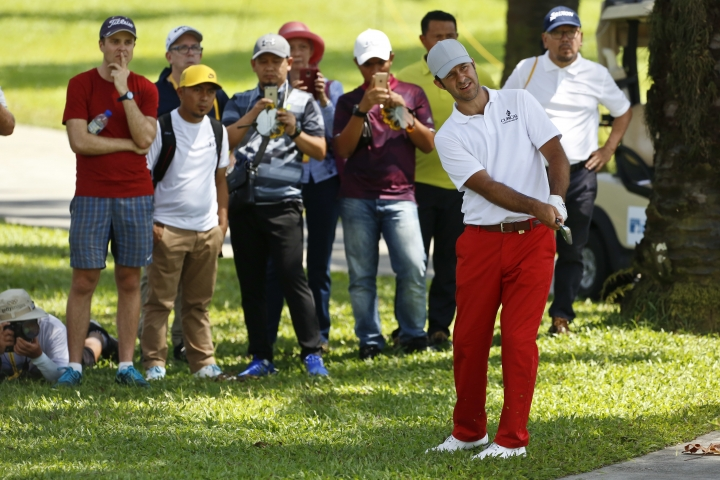 Jorge Campillo of Spain looks to his shot on the 18th hole during the third round of the Maybank Championship golf tournament in Shah Alam, Malaysia, Saturday, Feb. 3, 2018. (AP Photo/Sadiq Asyraf)