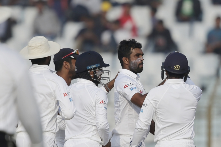 Sri Lanka's Dilruwan Perera, second right, celebrate with his teammates the dismissal of Bangladesh's Imrul Kayes during the fourth day of their first test cricket match in Chittagong, Bangladesh, Saturday, Feb. 3, 2018. (AP Photo/A.M. Ahad)