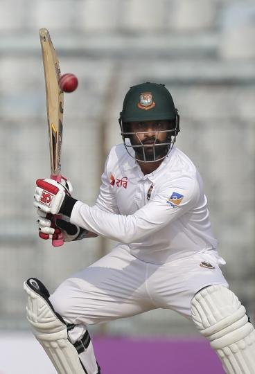 Bangladesh's Tamim Iqbal plays a shot during the fourth day of their first test cricket match against Sri Lanka in Chittagong, Bangladesh, Saturday, Feb. 3, 2018. (AP Photo/A.M. Ahad)
