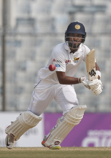 Sri Lanka's captain Dinesh Chandimal plays a shot during the fourth day of their first test cricket match against Bangladesh in Chittagong, Bangladesh, Saturday, Feb. 3, 2018. (AP Photo/A.M. Ahad)