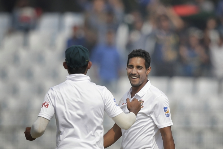 Bangladesh's Sunzamul Islam, right, celebrates with teammate Mosaddek Hossain the dismissal of Sri Lanka's Dilruwan Perera during the fourth day of their first test cricket match in Chittagong, Bangladesh, Saturday, Feb. 3, 2018. (AP Photo/A.M. Ahad)