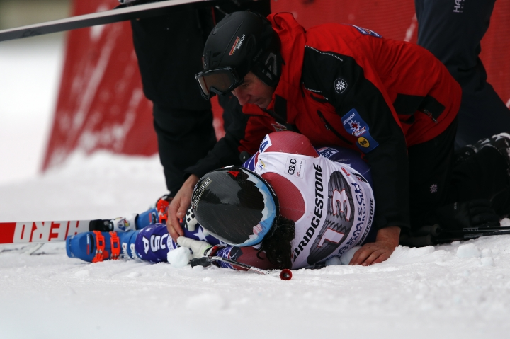 United States' Jacqueline Wiles lies on the track after falling during an alpine ski, women's world Cup downhill race, in Garmisch Partenkirchen, Germany, Saturday, Feb. 3, 2018. (AP Photo/Gabriele Facciotti)