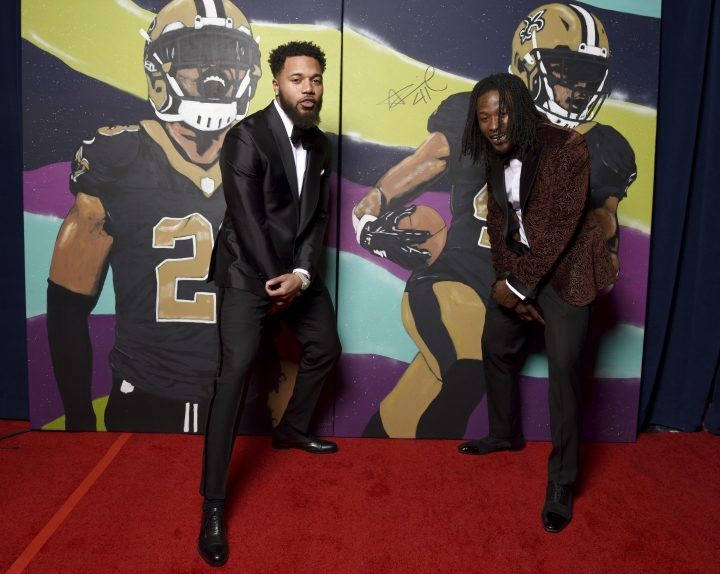 In this photo provided by the NFL, Marshon Lattimore, left, and Alvin Kamara, of the New Orleans Saints pose backstage with their portraits at the 7th Annual NFL Honors at the Cyrus Northrop Memorial Auditorium on Saturday, Feb. 3, 2018, in Minneapolis. (Peter Barreras/NFL via AP)
