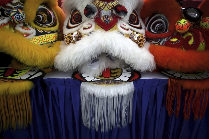 In this Friday, Feb. 2, 2018, photo, the lion heads of costumes are lined up on stage during the 11th International Lion Dance Competition in Singapore. This lion dace competition is usually held in a lead up to the Chinese Lunar New Year celebrated in Singapore. Lion dance is a traditional dance in Chinese culture and some other Asian countries in which performers from a lion dance troupe will mimic a lion's movements while dressed in a lion's costume. This is believed to bring fortune and luck. These performers from Vietnam, Singapore, Myanmar, Indonesia, Hong Kong, Taiwan and Malaysia gathered in Singapore to compete against one another and are judged on their skill, grace and musicality amongst other things. (AP Photo/Wong Maye-E)