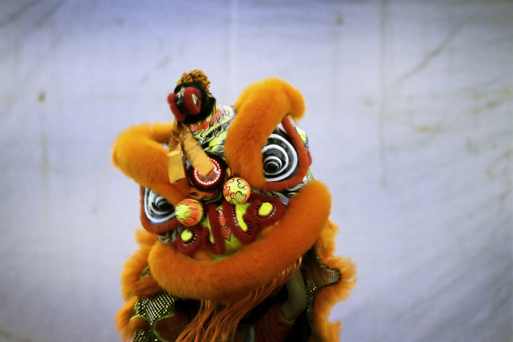 CORRECTS TO TROUPE - In this Friday, Feb. 2, 2018, photo, members of a lion dance troupe from Singapore compete in the 11th International Lion Dance Competition in Singapore. This lion dace competition is usually held in a lead up to the Chinese Lunar New Year celebrated in Singapore. Lion dance is a traditional dance in Chinese culture and some other Asian countries in which performers from a lion dance troupe will mimic a lion's movements while dressed in a lion's costume. This is believed to bring fortune and luck. These performers from Vietnam, Singapore, Myanmar, Indonesia, Hong Kong, Taiwan and Malaysia gathered in Singapore to compete against one another and are judged on their skill, grace and musicality amongst other things. (AP Photo/Wong Maye-E)