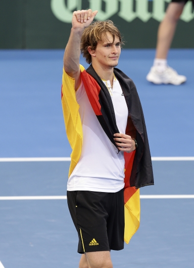 Alexander Zverev of Germany reacts after he won his match against Nick Kyrgios of Australia at the Davis Cup World Group first round in Brisbane, Australia, Sunday, Feb. 4, 2018. (AP Photo/Tertius Pickard)