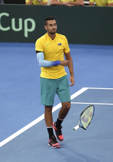 Nick Kyrgios of Australia throws his racquet to the ground in his match against Alexander Zverev of Germany at the Davis Cup World Group first round in Brisbane, Australia, Sunday, Feb. 4, 2018. (AP Photo/Tertius Pickard)