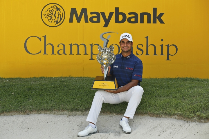 India's Shubhankar Sharma poses with his trophy after winning the Maybank Championship golf tournament in Shah Alam, Malaysia, Sunday, Feb. 4, 2018. (AP Photo/Sadiq Asyraf)