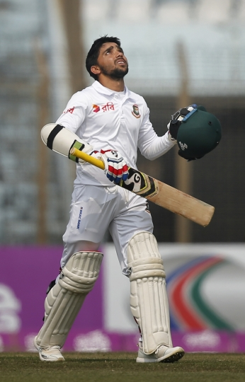 Bangladesh's Mominul Haque looks skywards to celebrate score hundred runs during the fifth and final day of the first test cricket match against Sri Lanka in Chittagong, Bangladesh, Sunday, Feb. 4, 2018. (AP Photo/A.M. Ahad)