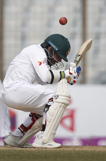 Bangladesh's Mominul Haque avoids a bouncer during the fifth and final day of the first test cricket match against Sri Lanka in Chittagong, Bangladesh, Sunday, Feb. 4, 2018. (AP Photo/A.M. Ahad)