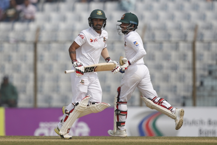 Bangladesh's Liton Das, left, and teammate Mominul Haque score a run during the fifth and final day of the first test cricket match against Sri Lanka in Chittagong, Bangladesh, Sunday, Feb. 4, 2018. (AP Photo/A.M. Ahad)