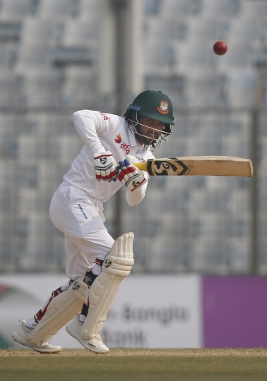 Bangladesh's Mominul Haque plays a shot during the fifth and final day of the first test cricket match against Sri Lanka in Chittagong, Bangladesh, Sunday, Feb. 4, 2018. (AP Photo/A.M. Ahad)