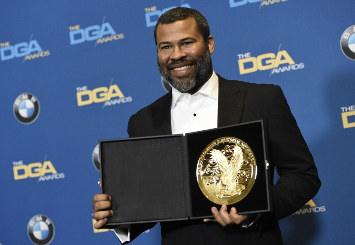 """Jordan Peele poses in the press room with the award for outstanding directorial achievement for a first-time feature film director for """"Get Out"""" at the 70th annual Directors Guild of America Awards at The Beverly Hilton hotel on Saturday, Feb. 3, 2018, in Beverly Hills, Calif. (Photo by Chris Pizzello/Invision/AP)"""