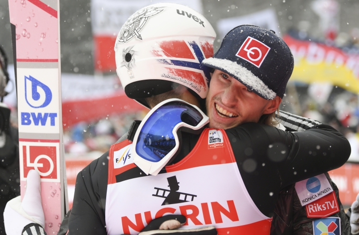 Norways's winner, Johann Andre Forfang, left, is hugged by teammate Daniel Andre Tande after the men's ski jumping World Cup in Willingen, Germany, Sunday, Feb. 4, 2018. (Arne Dedert/dpa via AP)