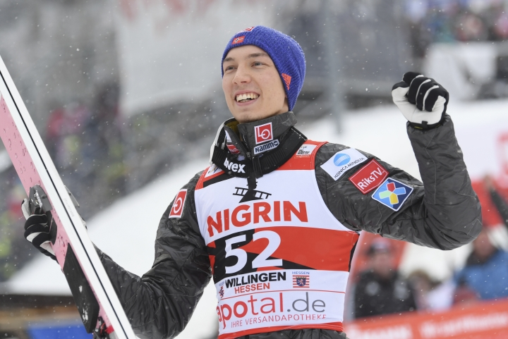Norway's winner Johann Andre Forfang celebrates after the men's ski jumping World Cup in Willingen, Germany, Sunday, Feb. 4, 2018. (Arne Dedert/dpa via AP)
