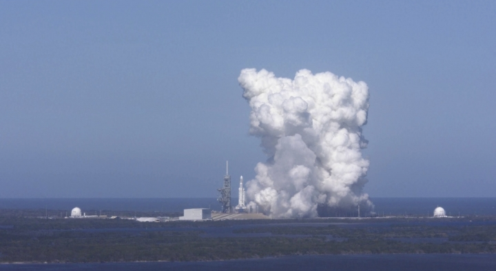 FILE - In this Wednesday, Jan. 24, 2018 image from video made available by SpaceX, a Falcon Heavy rocket is test fired at Cape Canaveral, Fla. NASA officials said the Falcon Heavy is just the latest evidence of the Kennedy Space Center's transformation into a multi-user spaceport, a total turnaround after decades of space shuttles taking center stage. (SpaceX via AP)