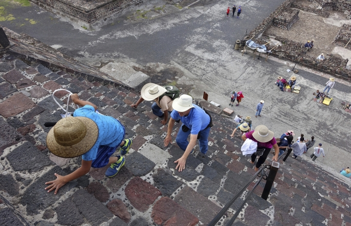 In this July 27, 2016 photo,tourists climb the Pyramid of the Moon at the ruins of Teotihuacan in Teotihuacan, Mexico. (AP Photo/Ross D. Franklin)