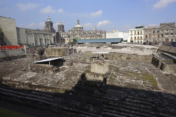 In this July 28, 2016 photo, the vast Templo Mayor pyramid complex ruins sit in the middle of the the bustling metropolis in Mexico City. (AP Photo/Ross D. Franklin)