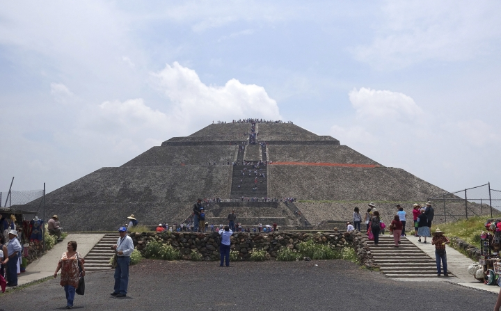 In this July 27, 2016 photo,tourists flock to the ancient Pyramid of the Sun at the ruins of Teotihuacan in Teotihuacan, Mexico. (AP Photo/Ross D. Franklin)