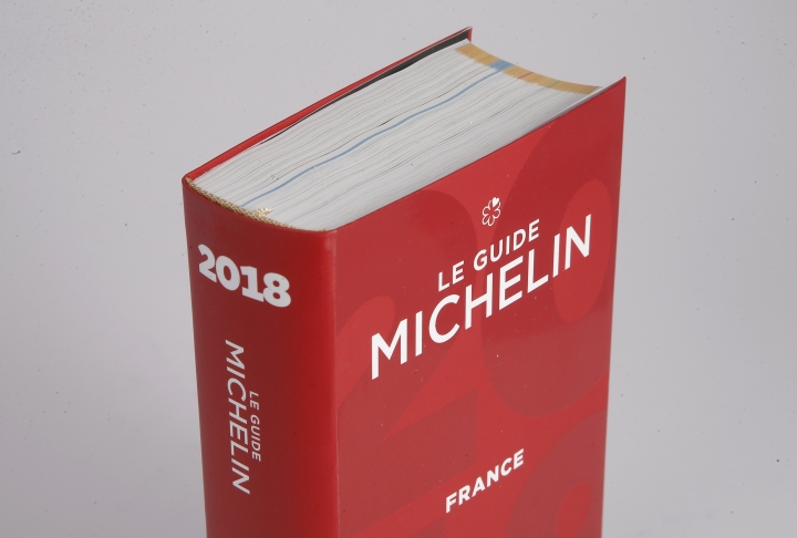 The Michelin Guide 2018 is pictured in Boulogne-Billancourt, outside Paris, France, Monday, Feb. 5, 2018. A record 28 French restaurants were honored with the gastronomic world's most coveted prize Monday: a three-star Michelin rating. (AP Photo/Michel Euler)