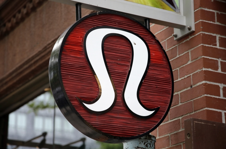 FILE - This Monday, June 5, 2017, file photo, shows a Lululemon Athletica logo outside a store on Newbury Street in Boston. On Monday, Feb. 5, 2018, Lululemon Athletica Inc. said Laurent Potdevin has resigned as CEO effective immediately, saying he fell short of the company's standards of conduct. (AP Photo/Steven Senne, File)