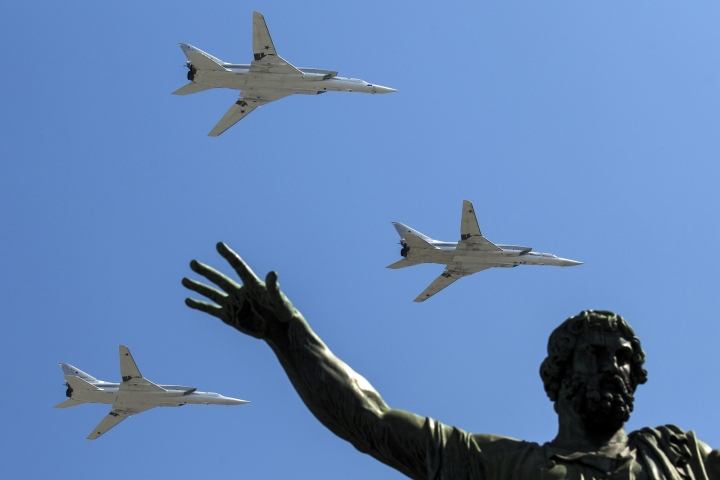 FILE - In this Monday, May 9, 2016 file photo, Russian Tu-22M-3 long-range bombers fly during the Victory Day military parade marking 71 years after the victory in WWII in Red Square in Moscow, Russia. Russia says it has met the nuclear arsenal limits of a key arms control treaty but has some issues with U.S. compliance. Monday, Feb. 5, 2018 was the deadline to verify compliance by both the United States and Russia with the New START treaty signed in 2010. (AP Photo/Pavel Golovkin, File)
