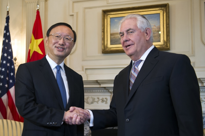 FILE - In this Feb. 28, 2017, file photo, U.S. Secretary of State Rex Tillerson shakes hands with Chinese State Councilor Yang Jiechi at the State Department in Washington. China says Yang will meet with U.S. Secretary of State Rex Tillerson amid concerns over North Korea. Yang would visit the U.S. on Thursday, Feb. 8 and Friday, Feb. 9, 2018. (AP Photo/Cliff Owen, File)