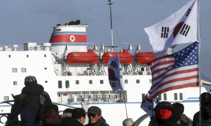 Members of conservative civic groups stage a protest against North Korea as North Korea's Mangyongbong-92 ferry, carrying North Korea's members of art troupe approaches to Mukho Port in Donghae, South Korea, Tuesday, Feb. 6, 2018. The art troupe, led by Hyon Song Wol, also the leader of the famous Moranbong girl band hand-picked by North Korean leader Kim Jong Un, will perform in Gangneung and Seoul on Feb. 8 and Feb. 11, respectively, before returning home. (Yang Yong-suck/Yonhap via AP)