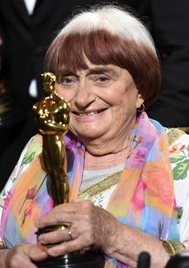 """FILE - In this Nov. 11, 2017 file photo, French film director Agnes Varda holds her honorary Oscar following the 2017 Governors Awards ceremony in Los Angeles. Varda received an honorary Academy Award recognizing her decades of filmmaking. She also shares the documentary feature Oscar nomination for """"Faces Places"""" with her co-director, JR, and her producer daughter, Rosalie Varda. (Photo by Chris Pizzello/Invision/AP)"""