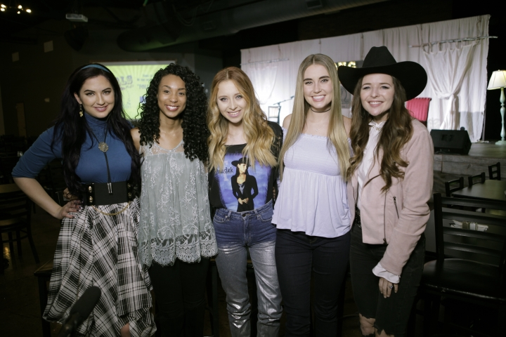 """In this Jan. 29, 2018 photo provided by Song Suffragettes, Inc., members of the Song Suffragettes, from left, Candi Carpenter, Tiera Leftwich, Kalie Shorr, Chloe Gilligan and Jenna Paulette pose for a photo in Nashville, Tenn. Female musicians in Nashville have long complained about the lack of representation on country radio, but now a collective of female songwriters are singing """"Time's Up."""" Nearly two dozen women, all belonging to the Song Suffragettes collective, sang on the """"Time's Up"""" song and music video released earlier this month. (Quinton Cook/Song Suffragettes, Inc. via AP)"""