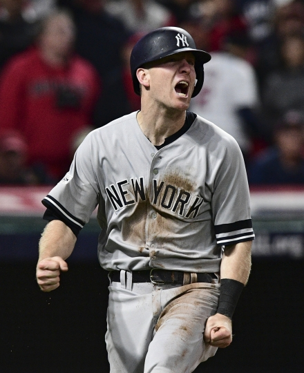 FILE - In this Wednesday, Oct. 11, 2017, file photo, New York Yankees' Todd Frazier celebrates after scoring in the ninth inning against the Cleveland Indians in Game 5 of a baseball American League Division Series, in Cleveland. On Monday, Feb. 5, 2018, a person familiar with the deal tells The Associated Press that free agent third baseman Todd Frazier and the New York Mets have agreed on a two-year contract for $17 million. (AP Photo/David Dermer, File)