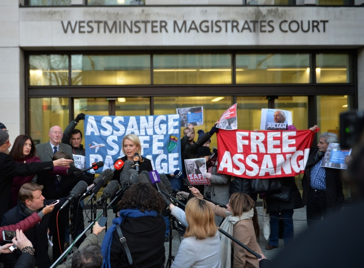 Jennifer Robinson, centre left, a lawyer representing Julian Assange, talks to the media outside Westminster Magistrates Court after the court ruled that an arrest warrant against Assange is still valid, in London, Tuesday Feb. 6, 2018. Lawyers for the WikiLeaks founder argued that the warrant should be dismissed, but following the verdict Tuesday, Assange would seem likely to continue his shelter within the Ecuadorian embassy in London. ( John Stillwell/PA via AP)
