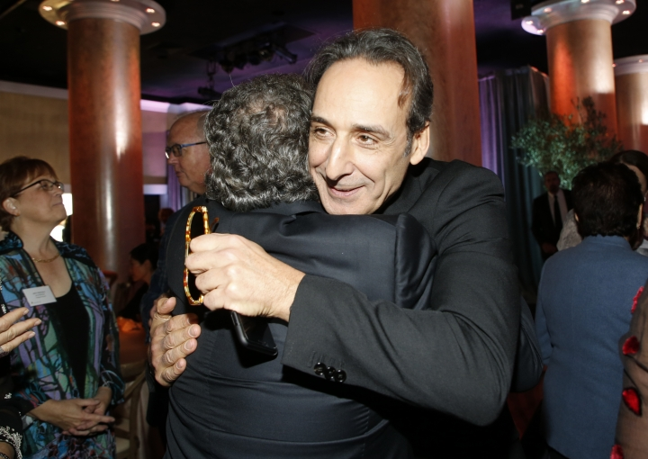 Jim Gianopulos, left, and Alexandre Desplat embrace at the 90th Academy Awards Nominees Luncheon at The Beverly Hilton hotel on Monday, Feb. 5, 2018, in Beverly Hills, Calif. (Photo by Danny Moloshok/Invision/AP)