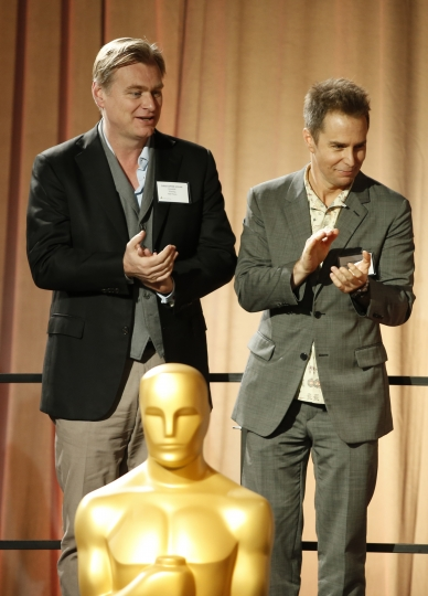 Christopher Nolan, left, and Sam Rockwell attend the 90th Academy Awards Nominees Luncheon at The Beverly Hilton hotel on Monday, Feb. 5, 2018, in Beverly Hills, Calif. (Photo by Danny Moloshok/Invision/AP)