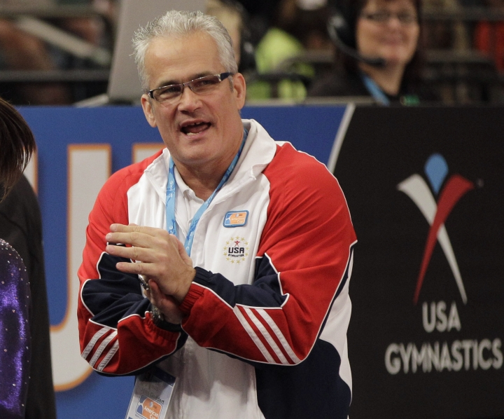 FILE - In this March 3, 2012, file photo, gymnastics coach John Geddert is seen at the American Cup gymnastics meet at Madison Square Garden in New York. Geddert, a former U.S. women's gymnastics national team coach, is facing a criminal investigation in Michigan after the sentencing of disgraced ex-sports doctor Larry Nassar, who treated girls at his elite club Twistars near Lansing. The Eaton County Sheriff's Office said Tuesday, Feb. 6, 2018, people have recently come forward with complaints against Geddert. (AP Photo/Kathy Willens, File)
