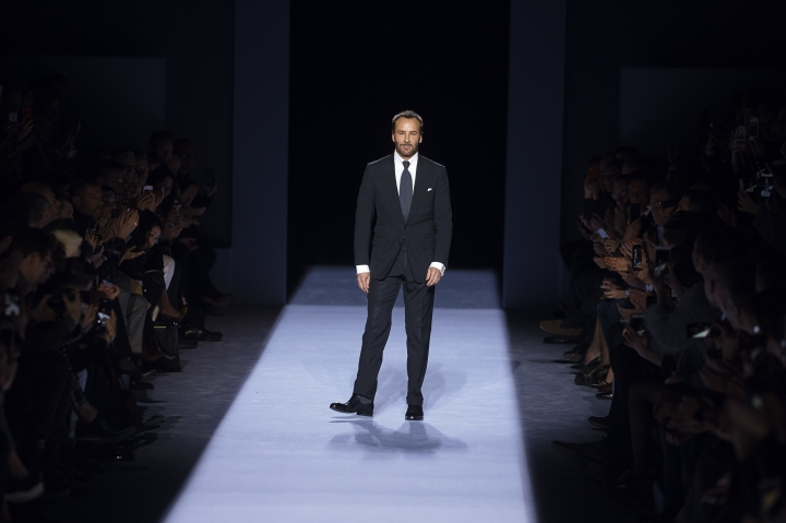 Designer Tom Ford salutes during his men's collection show at the Men's Fashion Week in New York, Tuesday, Feb. 6, 2018. (AP Photo/Andres Kudacki)